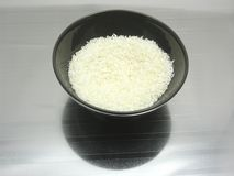 Black bowl of chinaware with coconut flakes Stock Photography