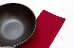 Black bowl and red napkin Royalty Free Stock Images