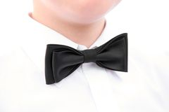 Black bowtie. Image of wedding accessory - black bowtie on the neck Stock Images