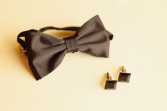 Black bowtie and buttons Royalty Free Stock Photos