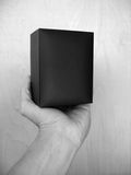 Black Box. A hand holding a black box. (BW royalty free stock images