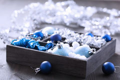 Black box full of christmas decoration Royalty Free Stock Photo