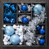 Black box full of christmas decoration Stock Photos