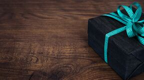 Black Box With Green Bow Accent Royalty Free Stock Image
