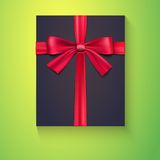 Black box, red ribbon, bow. Black box tied red ribbon with the bow, on colored background Stock Photo