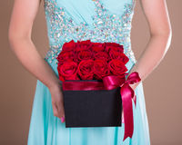 Black box with red rose flowers in female hands Stock Image