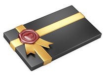 Black box with sealing wax and gold ribbon Stock Photo