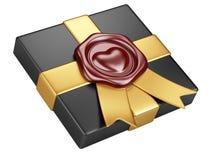 Black box with sealing wax and gold ribbon Royalty Free Stock Photography