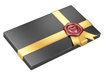 Black box with sealing wax and gold ribbon Stock Images