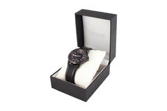 Black box with watch on white background. Black box with luxury watch on white background Stock Images