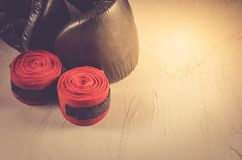 black boxing gloves and red bandage/sport concept with black boxing gloves and red bandage. Toned and copyspace royalty free stock photo