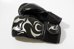 Black boxing gloves in a white background royalty free stock photography