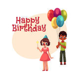 Black boy with balloons and caucasian girl in birthday cap Stock Image
