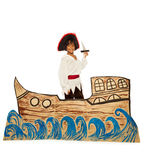 Black boy in costume of pirate on cardboard ship. Boy playing in home theater wearing pirate costume and sailing on cardboard ship holding dagger looking at Stock Image