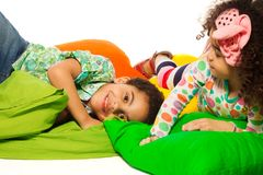 Black boy and girl playing with pillows Stock Photography