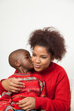 Black boy kissing his mother Stock Photography