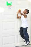 Black boy play ball. Young black boy playing basket ball in front of garage Royalty Free Stock Images