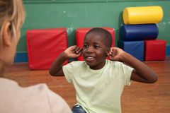 Black boy playing in the kindergarten royalty free stock photography