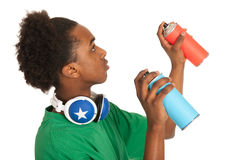 Black boy spraying graffiti Stock Photos
