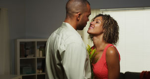 Black boyfriend surprises girlfriend with flowers Stock Photo