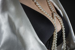 Black bra with pearls. And dressing-gown Royalty Free Stock Images