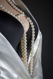 Black bra and pearls Stock Photography