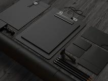 Black  branding elements on black wood background Royalty Free Stock Images