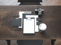 Black branding mockup on the wooden table. 3d rendering stock images