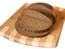 Black bread on board. On white background Royalty Free Stock Photography