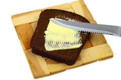 Black bread and butter Stock Photography
