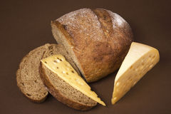 Black bread and cheese. On a brown background Stock Photo