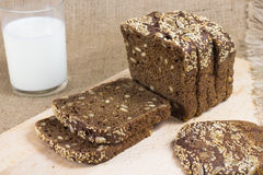 Black bread cut into slices.  glass of milk Stock Images