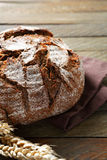 Black bread with ears of wheat Stock Photography