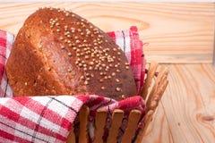 Black bread with fresh coriander closeup. Black bread with fresh coriander seeds closeup Royalty Free Stock Images