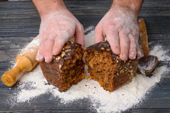 Black bread in the hands of men Royalty Free Stock Images