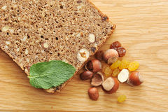 Black bread with hazelnuts. And raisins on a wooden Board Stock Photo