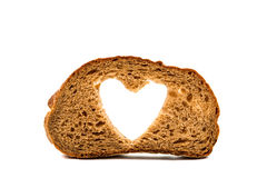 Black bread with a heart Royalty Free Stock Photography