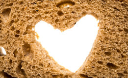 Black bread with a heart Stock Image