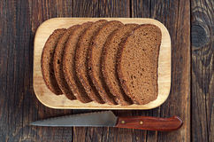 Black bread and a knife Royalty Free Stock Photo