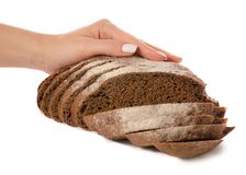 Black bread rye on hand. On a white background isolation Royalty Free Stock Photo
