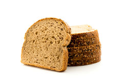 Black bread with seeds isolated. Black bread with seeds on white background, isolated Stock Images