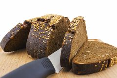 Black bread sliced ​​on a cutting board Royalty Free Stock Image