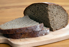 Black bread slices on the cutting board Royalty Free Stock Photo