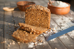 Black bread slices with seeds. Fresh bread on the rustic wooden table Stock Image