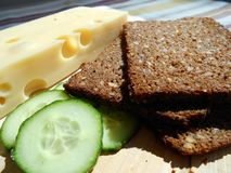 Black bread with sunflower seeds, cheese and cucumber Stock Image