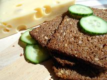 Black bread with sunflower seeds, cheese and cucumber Royalty Free Stock Images