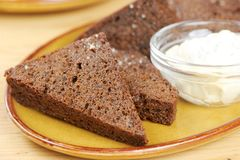 Black bread toasts with garlic sauce on a plate Stock Photography