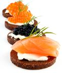Black bread with salmon fish, trout and sturgeon caviar Royalty Free Stock Photography