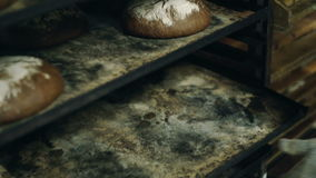Black bread on trays. Black bread is removed from trays stock footage