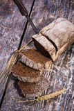 Black  bread on a wooden background Stock Images